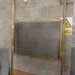 brass-and-perforated-steel-partition-panel