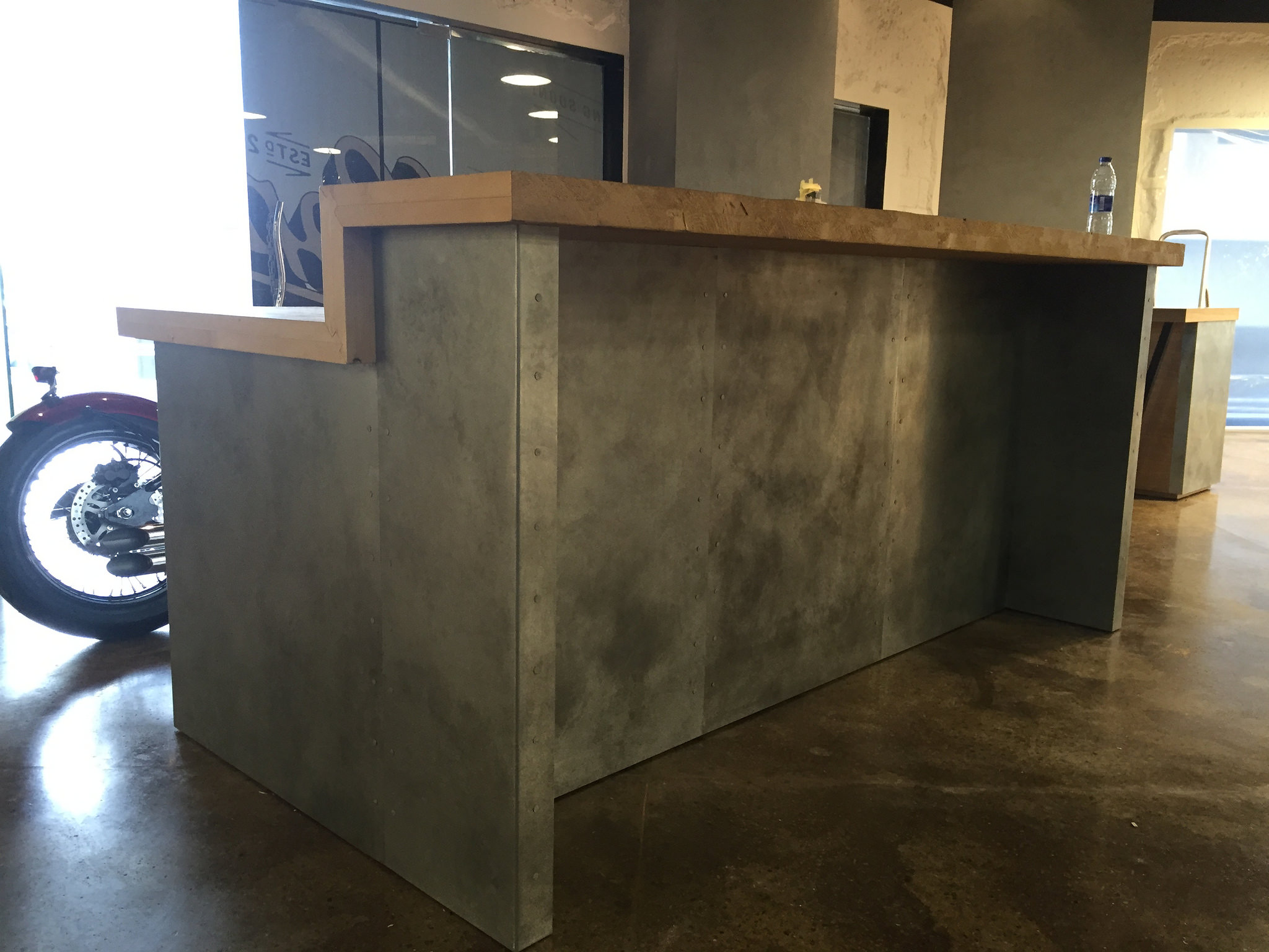 Light Patina Zinc Cladding To Reception Desk Metal